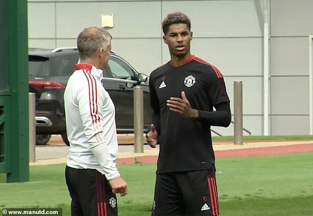 Rashford (right) was then seen at Manchester United's training ground with manager Ole Gunnar Solskjaer (left) as he continued to take positive steps in his recovery.