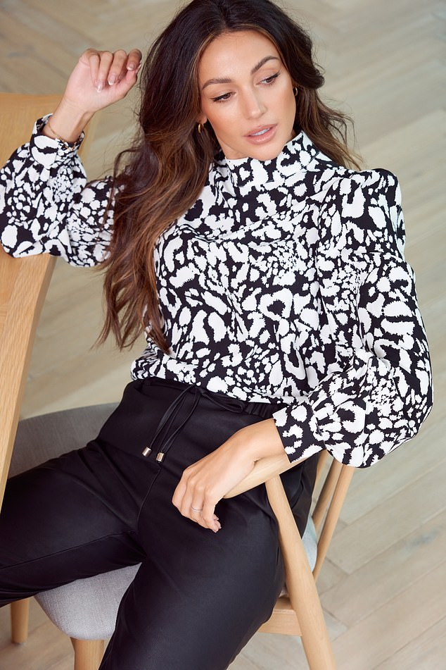 Smart: Another look saw her slipping into a black and white blouse and high waisted pants