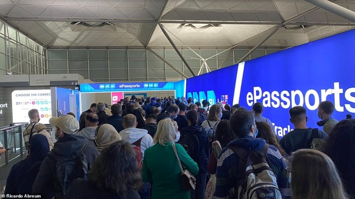 People wait a long time to pass through the passport gate after landing at London Stansted Airport last night