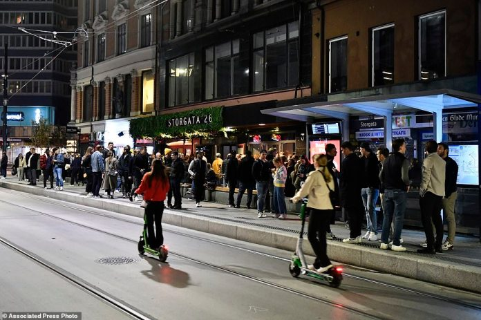 People take to the streets to celebrate the end of COVID-19 restrictions in Oslo on Saturday.  Police in Oslo received no less than 190 reports of disturbances, which was slightly less than what was expected to be dealt with on New Year's Eve.