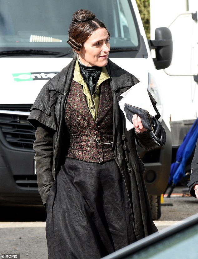 Iconic: Sporting her iconic outfit complete with leather gloves, the actress walked through the woods as she prepared to film more scenes