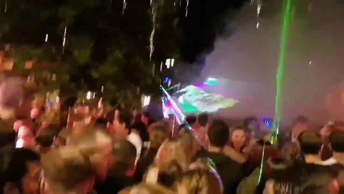 Smoke is released during a sudden rush on the streets of Stavanger on Saturday night