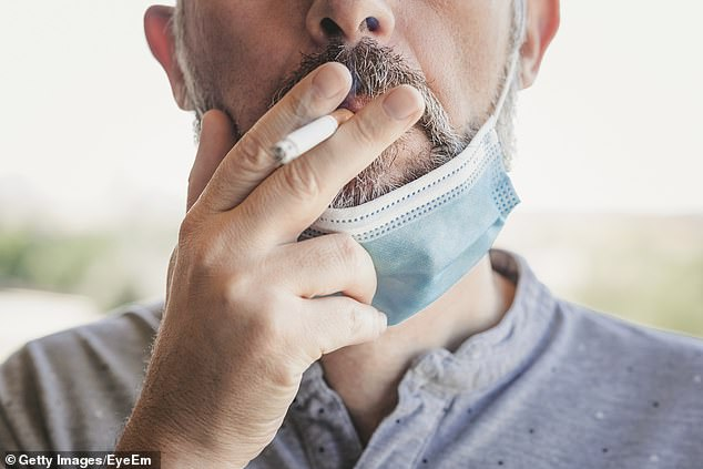 Covid-infected smokers are more likely to be hospitalised or die than those that have never smoked, research suggests. It comes after other papers at the start of the pandemic suggested the opposite was the case (stock image)