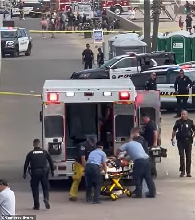 A portion of the beach was closed while paramedics attended and the man was loaded into an ambulance