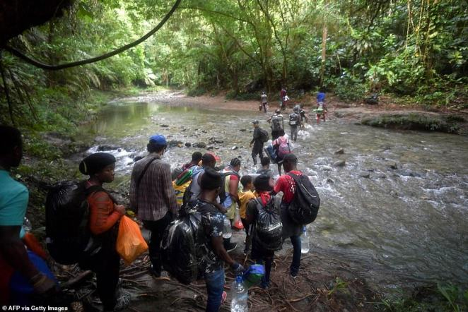 Haitian migrants cross the jungle of the Darien Gap, near Acandi, Choco department, Colombia, heading to Panama, on September 26, 2021, as they try to reach the US