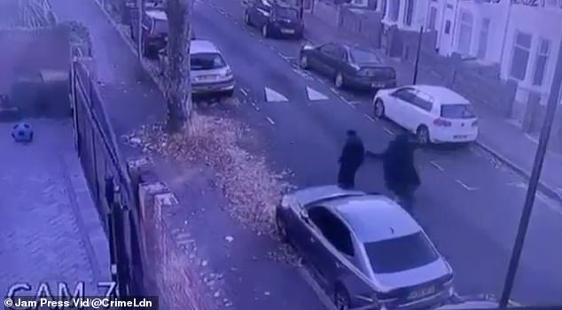 This is the shocking moment, caught on CCTV, when a 'schoolboy' was mugged by two youths who stole his scooter and £160 Apple AirPods on aa residential street in east London