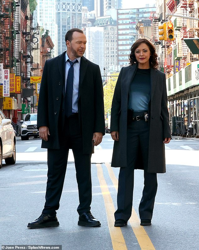 Dressed for the occasion: The performers both opted for long jackets and dark blue trousers while working on the series' upcoming twelfth season