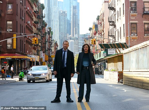 Hard at work:Donnie Wahlberg and Marisa Ramirez were seen working on the New York City set of Blue Bloods on Monday
