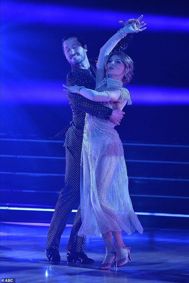 Viennese waltz:Earlier in the night on television, Olivia came out to dance she gave her partner Val Chmerkovskiy, a two-time DWTS champion, a makeover. She gave him a headband and put on bright purple eyeshadow