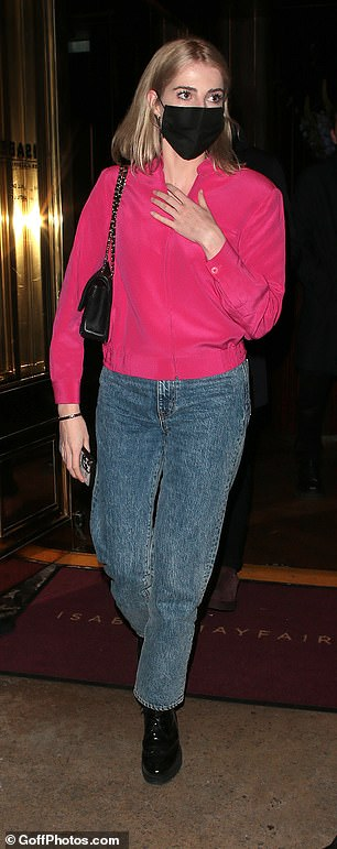 Stylish: Lucy looked effortlessly cool for the romantic dinner as she headed out in a fuschia jacket and jeans