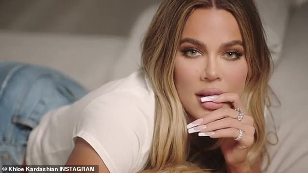 A nail biter: Khloe also put one of her fingers in her mouth as she flashed a long nailed French manicure