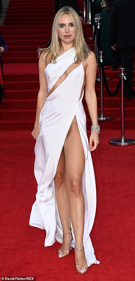 One of the fashion misses of the night was reality TV star Kimberley Garner, who flashed her underwear in an attention-grabbing white gown with a dramatic side slit