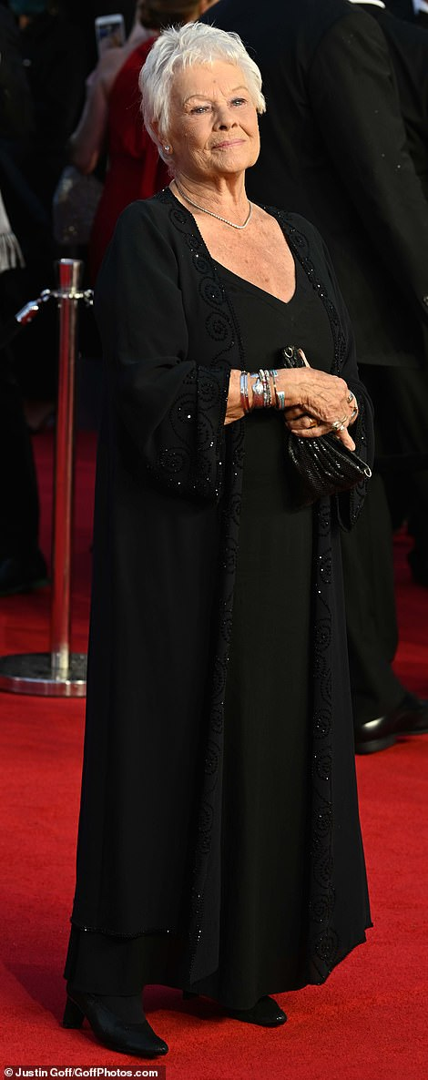 Epitome of elegance: Dame Judi Dench proved less really is more in a sweeping black ensemble of a top, trousers and flowing long shawl with embellishment