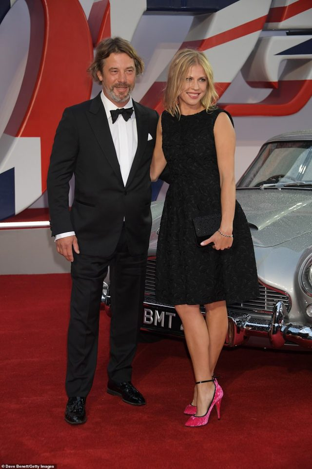 Sharp: Songwriter Jay Kay opted for a sharp suit and was joined by a glam female companion