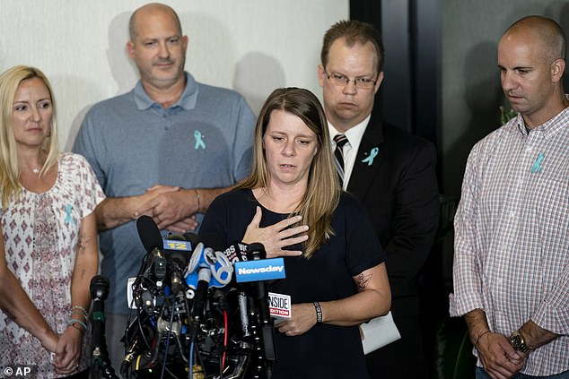 Gabby's mother and stepfather, Nichole (center) and Jim Schmidt, and father and stepmother, Joe and Tara Petito, were joined by their lawyer as they addressed the media for the first time since their daughter's body was found
