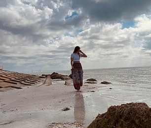 In more snaps Gabby is seen reading a true crime novel book on the beach, exploring the dunes and holding a starfish in the palm of her hand