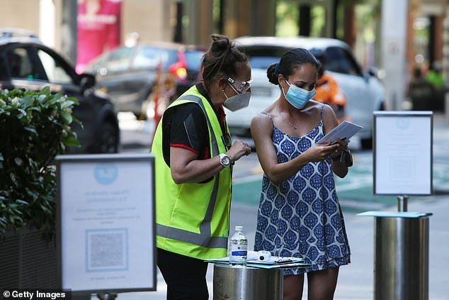 The Governor claimed Australia isn't a free country and questioned whether those in communist China had more freedoms (pictured a Sydneysider at a vaccination hub)