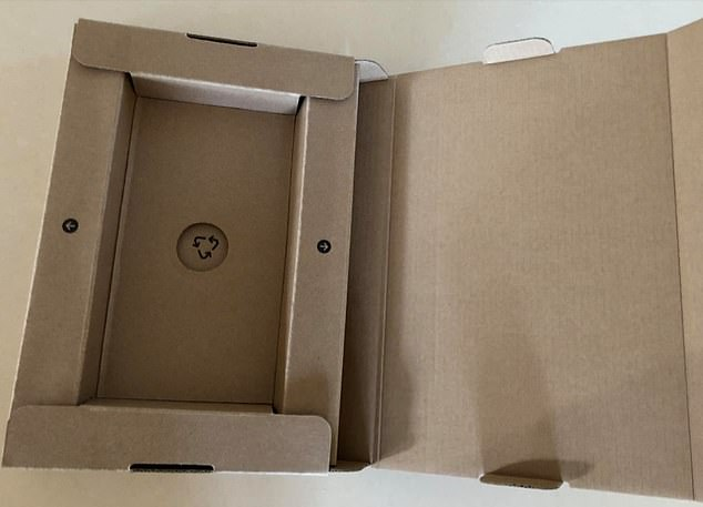 Apple's new iPhone 13 comes without a wall charging port, sparking outrage from tech-savvy buyers of the device (pictured, the iPhone's packaging)