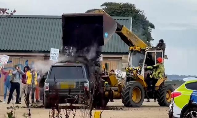 In a prank orchestrated by Ant and Dec's Saturday Night Takeaway, a man wearing a mask and hat drives a digger towards the TV host car and covers it in the compost as Clarkson looks on