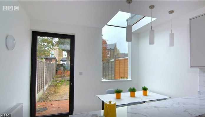 Kitchen After: After looking at competing designs, Jacqueline and Jamie opted to commission Lizzie.  They were specially taken from her idea for a large kitchen with combined wall and skylight (pictured)
