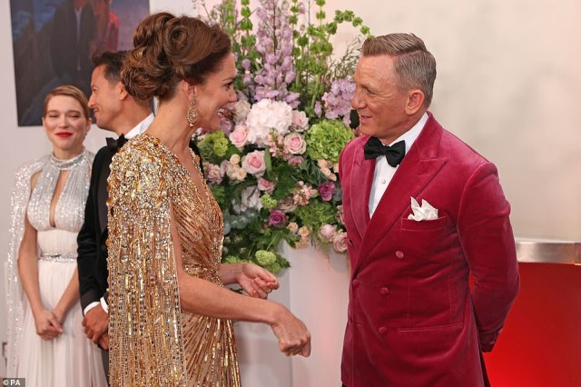 The Duchess of Cambridge meets James Bond actor Daniel Craig upon her arrival at the No Time To Die premiere on Tuesday. Craig struggled to maintain his composure, uttering with his understated British sensibility: 'You look jolly lovely'