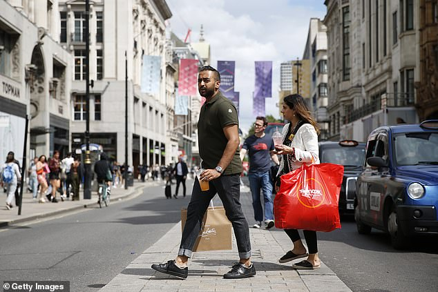 The first lockdown in 2020 was a 'live social experiment' that showed men are less likely to accept their movement being restricted and tend to return to normal more quickly than women, the research showed. Pictured, Oxford Street in London