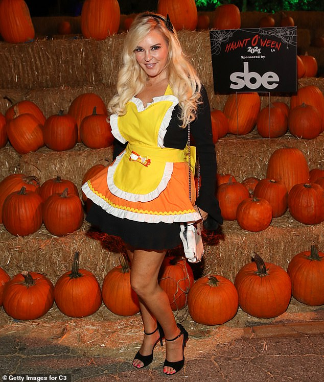 The girl next door:Girls Next Door star Bridget Marquardt a dressed up as a piece of candy corn with a white purse on her shoulder