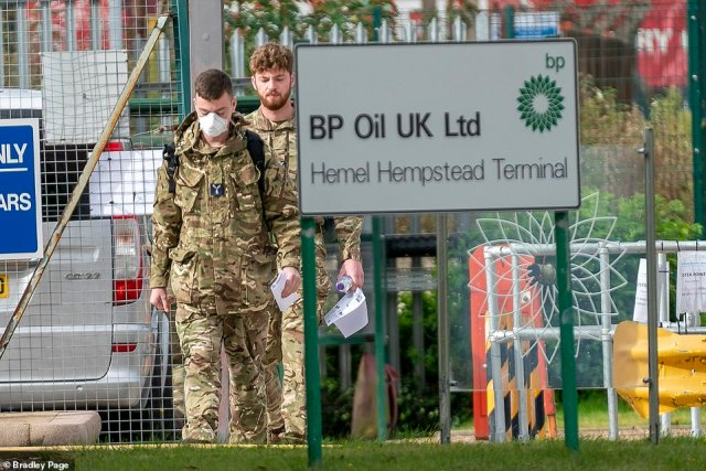 Nearly 200 military drivers are being deployed to the worst-hit areas, Downing Street confirmed. Pictured: Military personnel seen at the BP Oil plantin Hemel Hempstead Herts