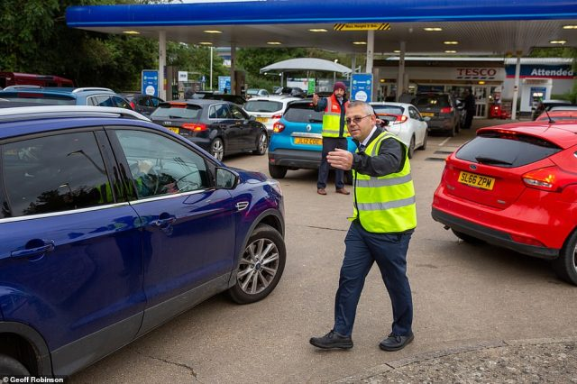 Staff were this morning directing the queues as the panic buying continues amid Britain's ongoing fuel crisis