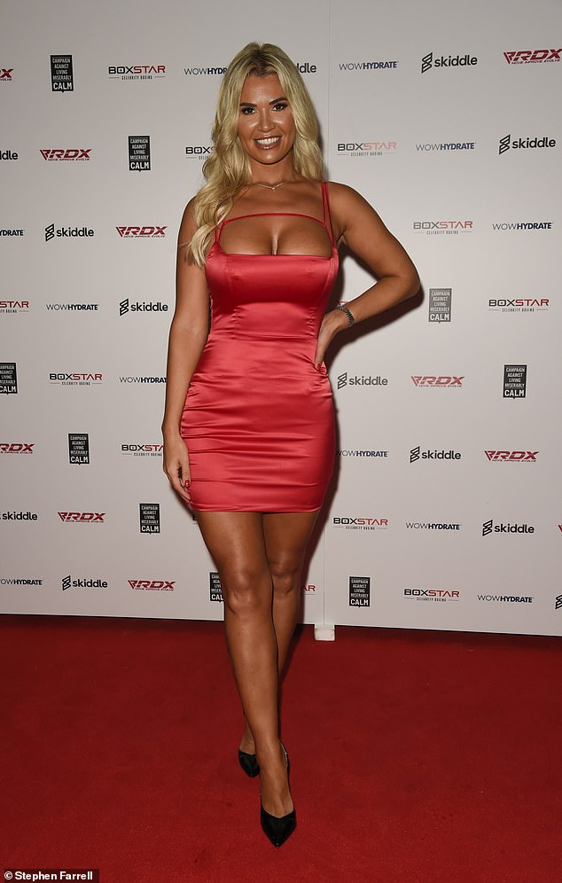 Wow: Christine McGuinness, 33, also looked sensational in a red mini dress as she created a storm at the event
