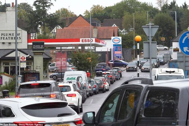 Greedy garage bosses were charging almost £3 for a litre of petrol yesterday amid warnings that the fuel crisis is worsening in London and the South East. Above: Fuel crisis rumbles on in Loughton, Essex
