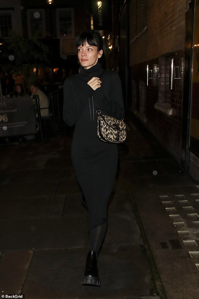 LOOKING GOOD: The 36-year-old singer and actress added a pop of color to her understated outfit, draping a leopard-print handbag over her shoulder