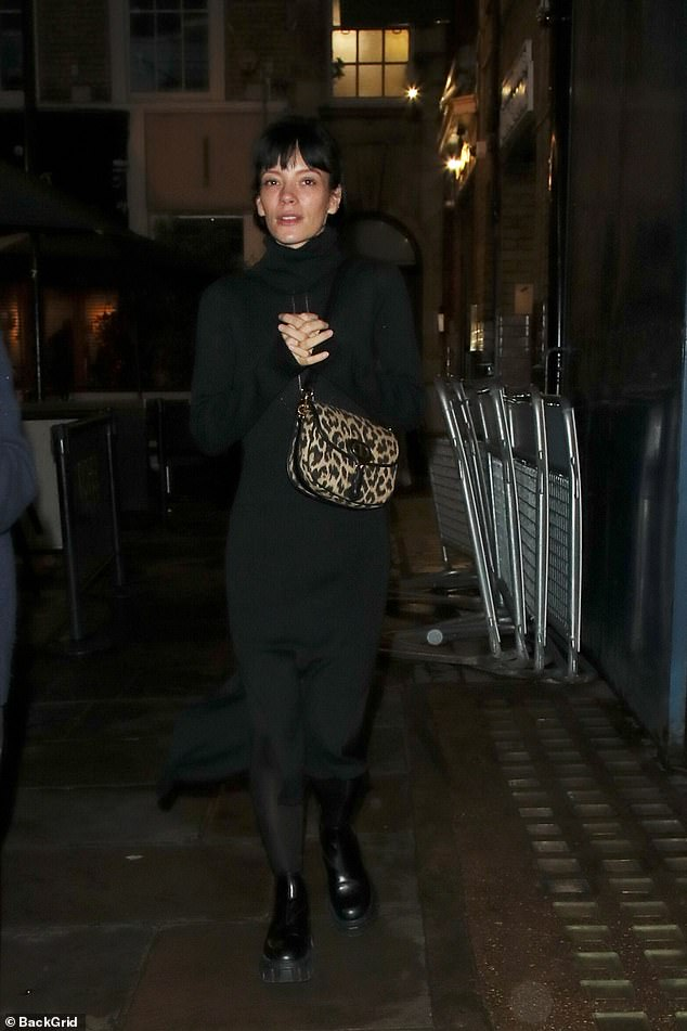 Casual Look: To keep warm during the chilly autumn weather, Lily wore black tights under chunky black ankle boots