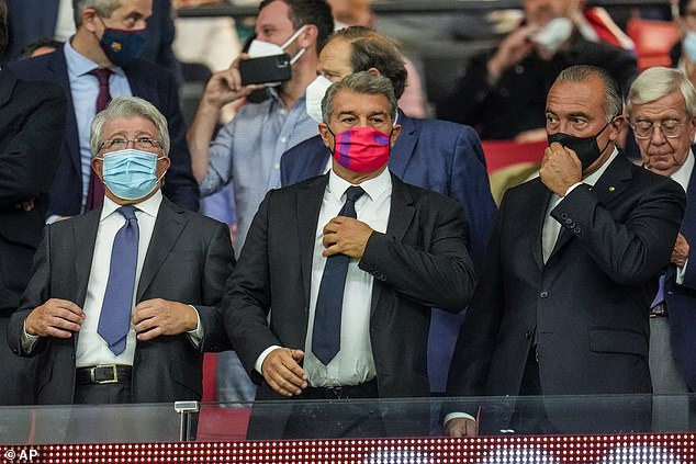 Barcelona president Joan Laporta (centre) extended his support to Koman before the defeat