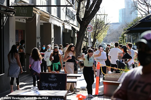 Victoria is set to hit the 70 per cent double-dose rate on October 26 and the 80 per cent target on November 5 (pictured, locals in South Yarra)
