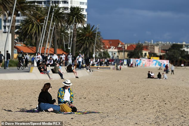 Mr Weimar said that of the 1,220 new Covid cases recorded on Sunday, up to 70 per cent were detected in people under the age of 40 (pictured, residents at St Kilda Beach)