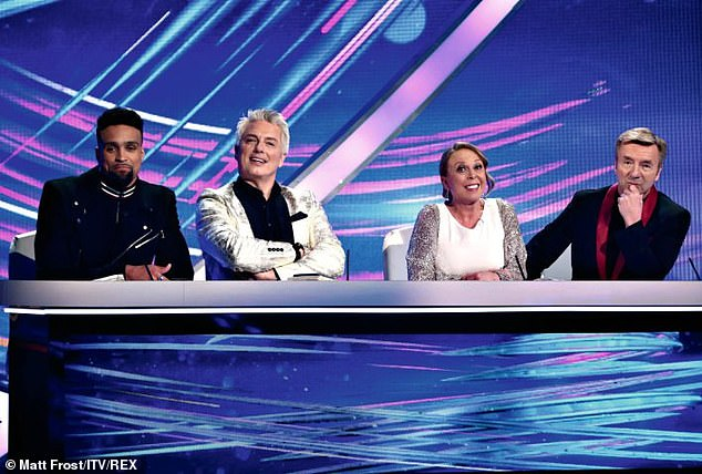 He Won't Be Back: John Ashley Appears on Judging Panel with Banjo, Jayne Torville and Christopher Dean (pictured February 2020)