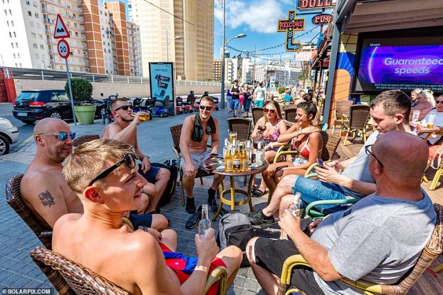 New rules intended to make travel 'easier and cheaper' came into force today, with fully vaccinated Britons no longer needing a test before flying back, as holidaymakers make the most of the rules by flocking to Benidorm to enjoy beers in the sun