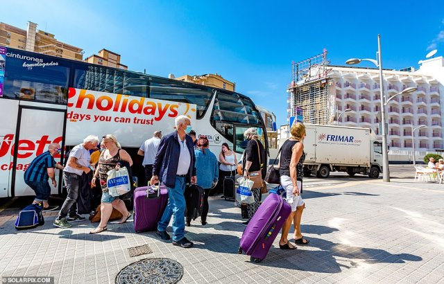 Package tour holiday coaches packed with new Brit arrivals were busy ferrying them from Alicante Airport to their Benidorm hotels today
