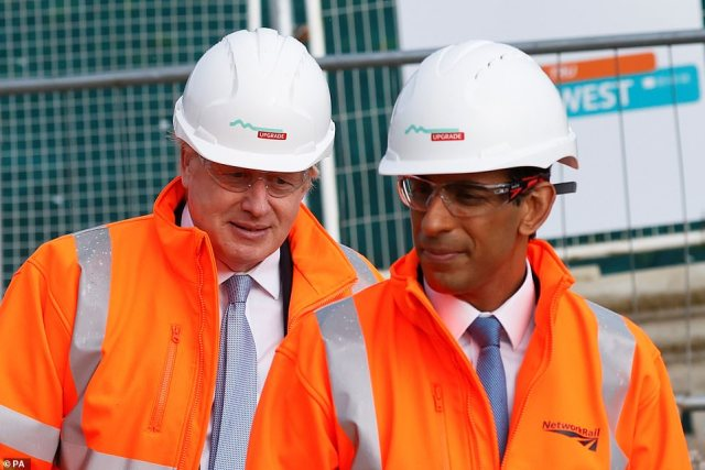 Rishi Sunak (pictured on a visit to a building site in Manchester with Boris Johnson today) has dodged over rumours of a stealth council tax rise to help fill the black hole in social care funding