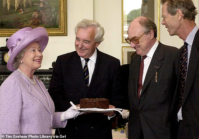The Queen presenting the Dundee Cake to members of Radio Four's Test Match Special Commentary Team (L to R) Peter Baxter, Henry Blofeld and Christopher Martin-Jenkins at Lord's Cricket Ground on July 19, 2001