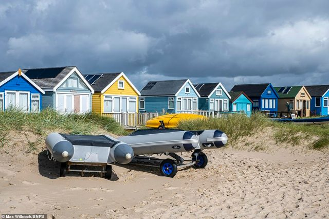 The prices of Britain's most expensive beach huts on the exclusive Mudeford Sandspit in Dorset (pictured) are on course to break through the £400,000 barrier due to the huge demand for them by rich staycationers looking to get away this summer
