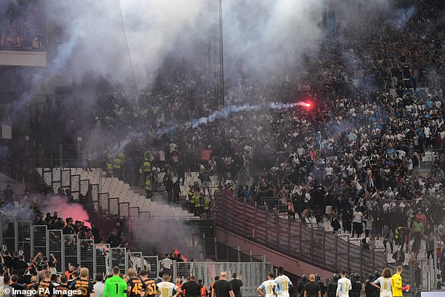 Marseille's Europa League clash with Galatasaray was halted when flares were thrown