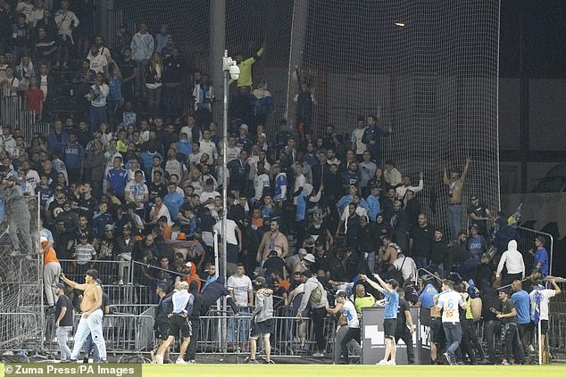 Marseille supporters invade the field during their away Ligue 1 trip against Angers