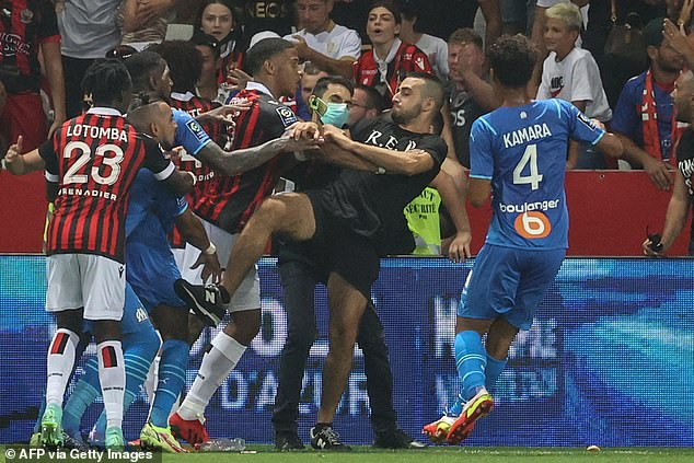 Marseille players clashed with Nice ultras after a bottle was thrown at Dimitri Payet