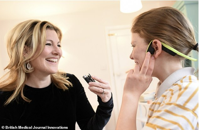 Experts from Cambridgeshire Community Services NHS Trust sent Bone conducting earphones and a wireless Bluetooth microphone (pictured) to families to determine if the Glu Ear can be self-managed.