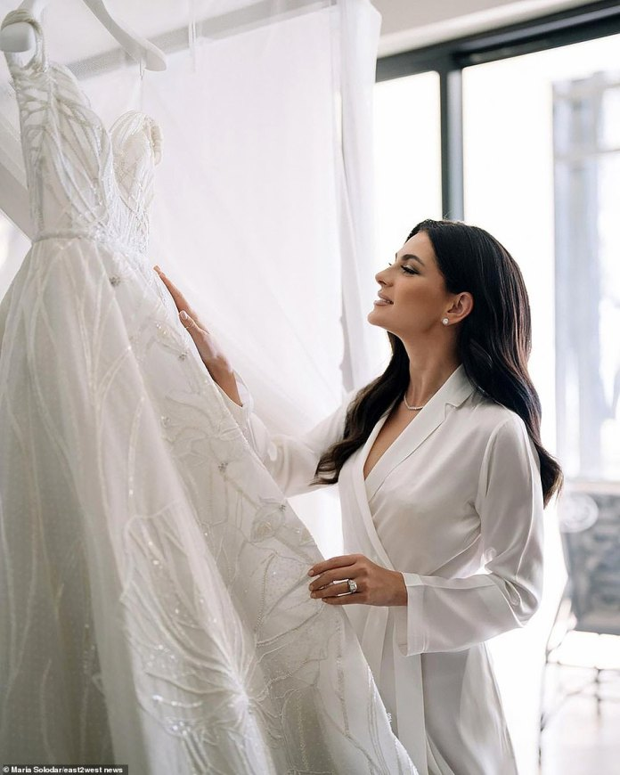 Getting ready: Maria says she's not into makeup and gets dressed in just one fitting - despite having two dresses on the big day