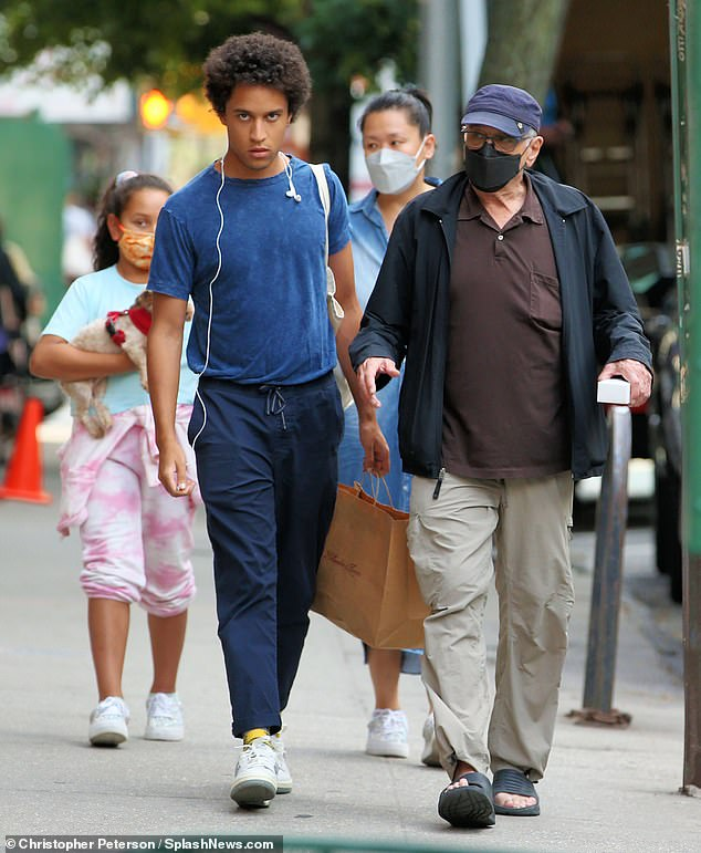 Out and about: Robert De Niro out in New York on Sunday with his three children and his rumored love interest Tiffany Chen