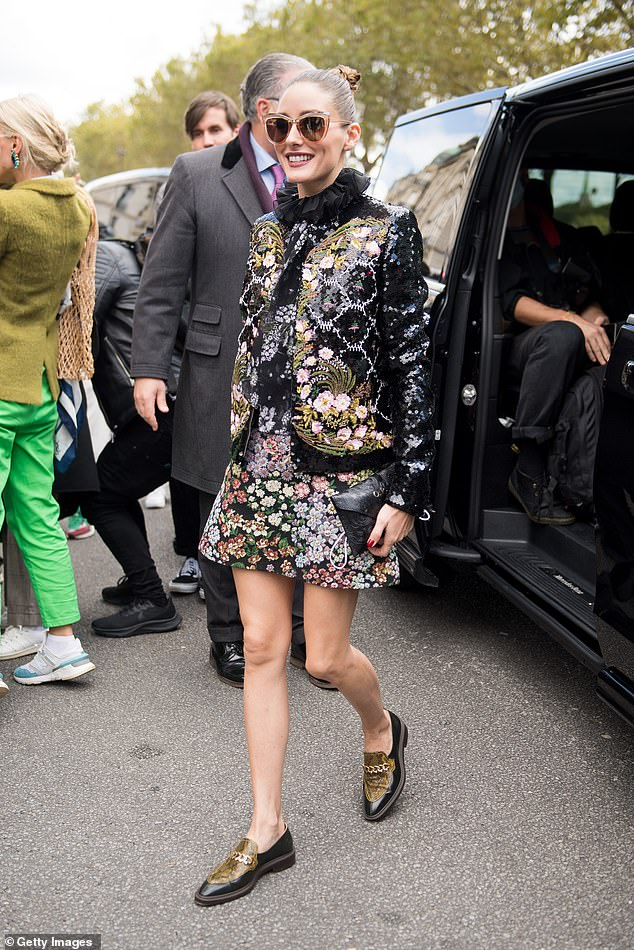 In Style: Olivia Palermo, 35, demonstrated her impeccable sense of style in a black sequin jacket with floral detailing at the Giambattista Valli show during Paris Fashion Week on Monday.