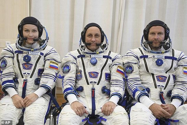 Actress Yulia Peresild, left, director Klim Shipenko right, and astronaut Anton Shkaplerov (center) are members of the main crew of the Soyuz MS-19 spacecraft
